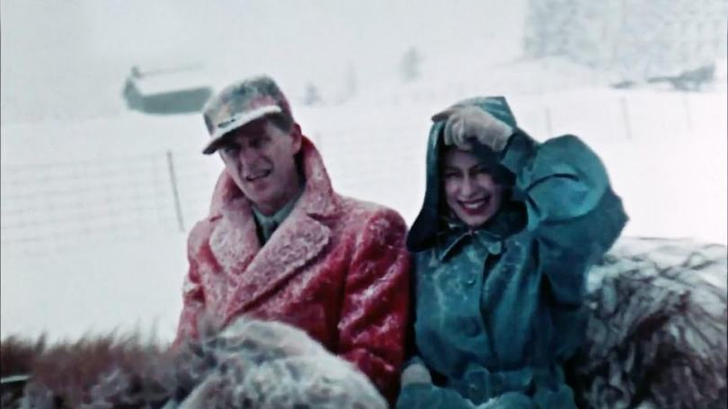 The young princess and the Duke of Edinburgh are seen covered in snow on their sleigh ride during the official tour