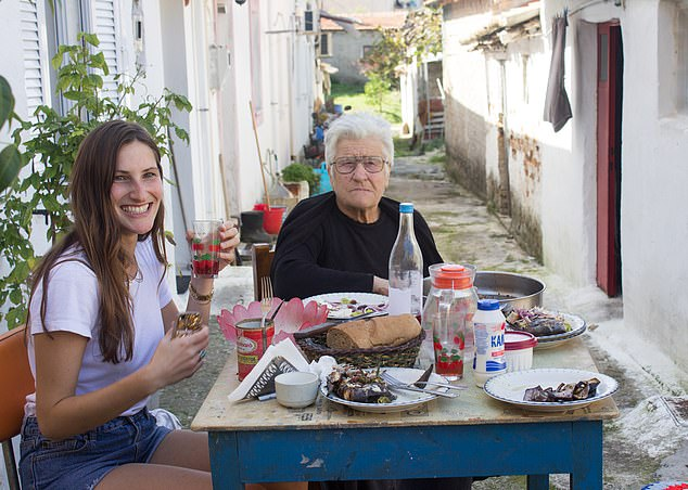 Family feast: Anastasia Miari with her inspirational grandmother, Yiayia, in Corfu