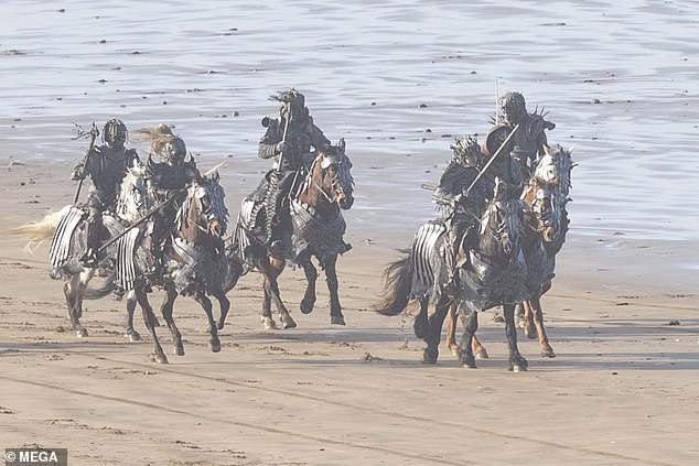 Tense:Meanwhile the horses looked equally ready for battle in metal armour covering their faces and bodies
