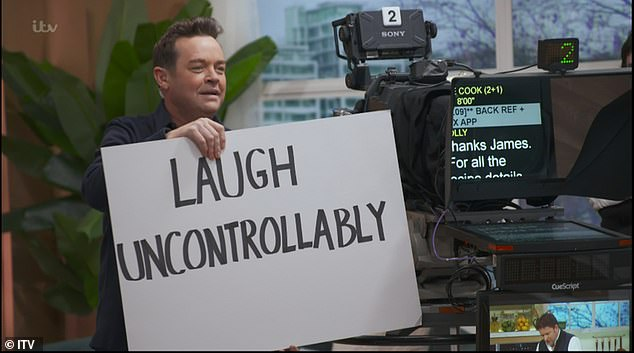Silly: Stephen also held up a sign during the This Morning broadcast that instructed Holly and Phil to 'laugh uncontrollably'