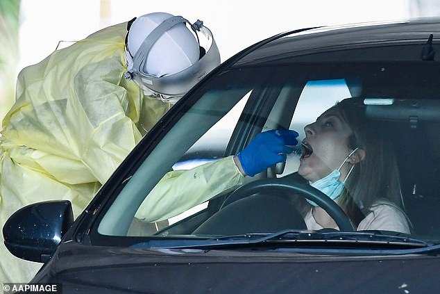 Dr Young said the scare is a reminder that Queensland is not out of the woods yet and that Covid still poses a major risk as she urged people to seek testing. Pictured: A drive through testing clinic in Brisbane back in January