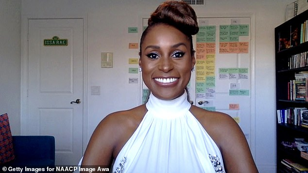 Comfy:The actress, 36, stunned in a radiant white halter gown with bejeweled adornments, as she looked to accept her award over Zoom from her home office