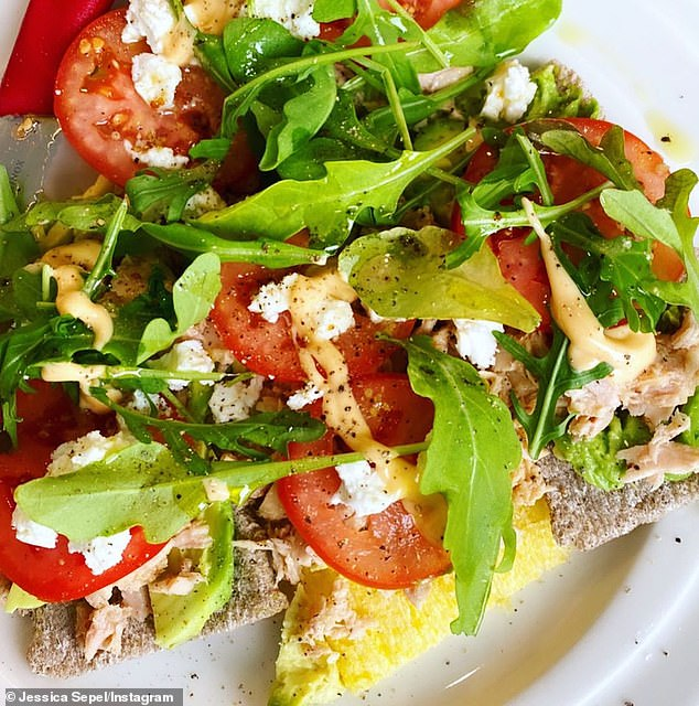 Jessica said her working lunch is always the same - healthy seed crackers or bread topped with avocado, hummus, sprouts, chicken or tuna, tomatoes and rocket leaves (pictured)