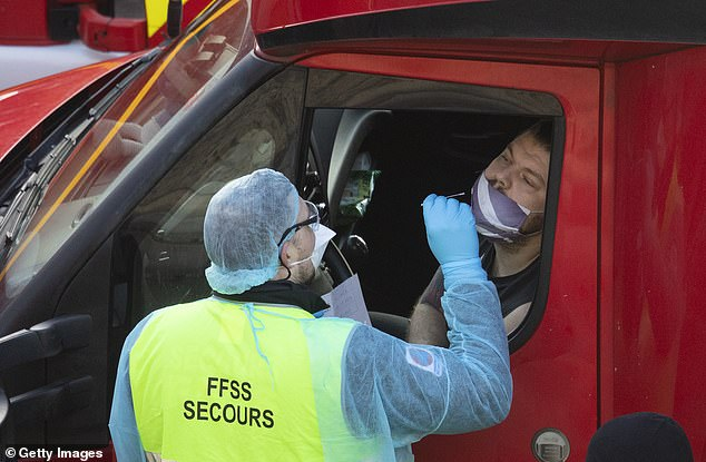 French officials started testing lorry drivers in Dover before they crossed the Channel in December last year (pictured). They dropped the scheme last week