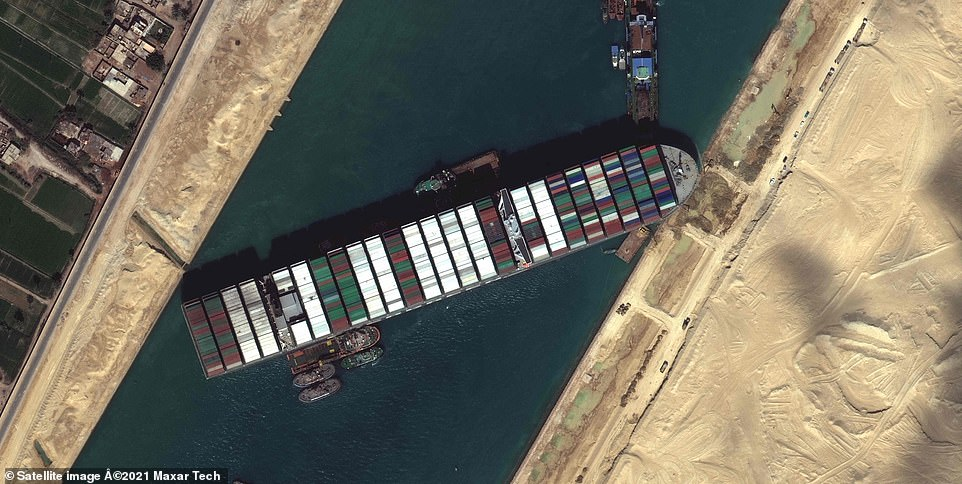 The massive Ever Given (pictured), a Panama-flagged, Japanese-owned ship that carries cargo between Asia and Europe, got stuck on Tuesday in a single-lane stretch of the canal