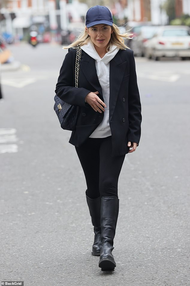 Edgy: Mollie King looked fashion forward as she as she wore a black pinstripe blazer over a white hoodie on her way to present her BBC Radio 1 show on Sunday