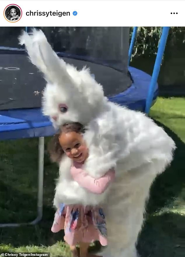 Holiday festivities: Chrissy's daughter Luna beamed with joy as she embraced the Easter Bunny