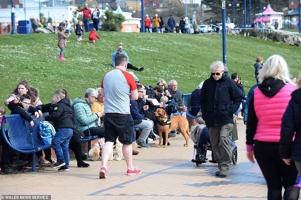 But non-essential travelers from England, Scotland and Northern Ireland are still banned from entering Wales until at least April 12. Pictured: Visitors at Barry Island on Saturday