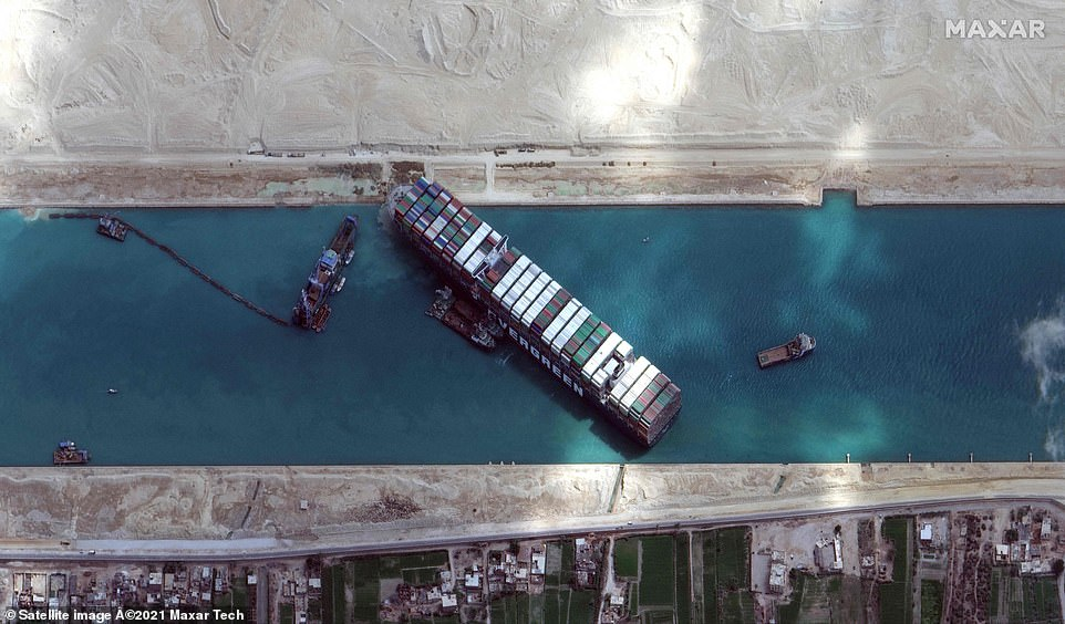 Satellite imagery released by Maxar Technologies shows the container ship in the Suez Canal on the morning of March 28