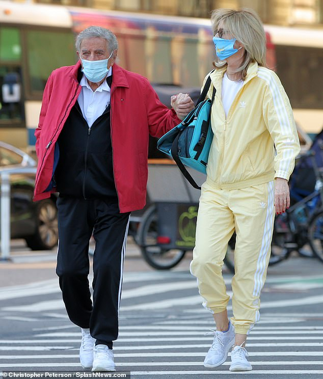 Coordinating outfits: The married couple both wore tracksuits and white athletic shoes while stepping out together