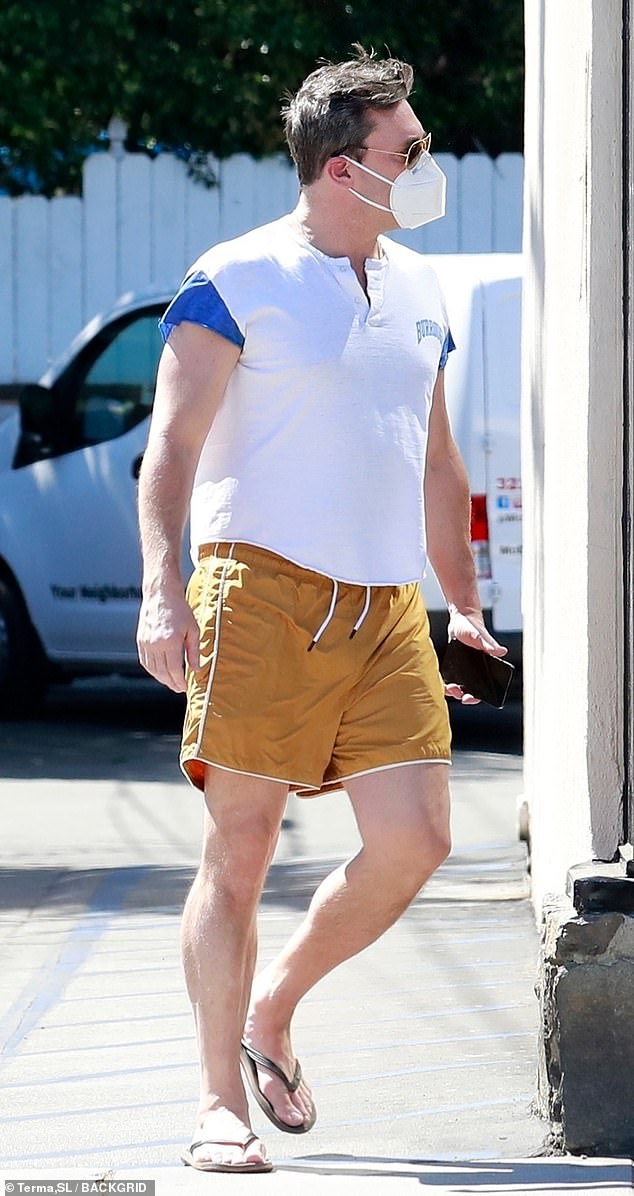 Summer running: With summer-like temperatures, the former Mad Men star stepped out in gold woven shorts, a white t-shirt and flip-flops