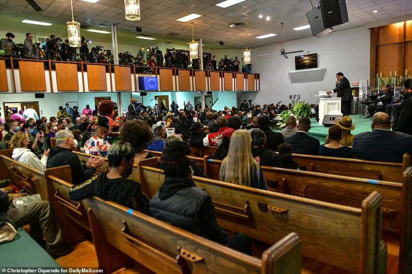 Mourners sit socially distanced on the pews during the prayer vigil in Minneapolis on Sunday