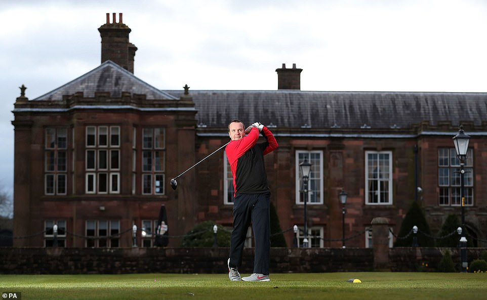 Simon Ledger tee's off at Vale Royal Abbey Golf Club, Cheshire following the easing of England's lockdown to allow far greater freedom outdoors