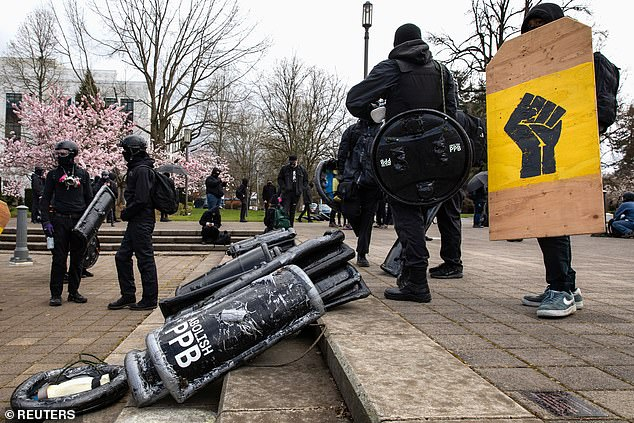 Anti-fascist protesters rally outside of the Oregon State Capitol building during an anti-fascist rally in Salem, Oregon