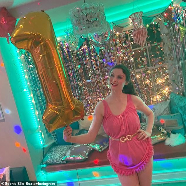 'Happy birthday, disco!': Sophie celebrated one year of her regularKitchen Disco at the end of March while wearing a pink nightdress and holding a balloon in the shape of the number one