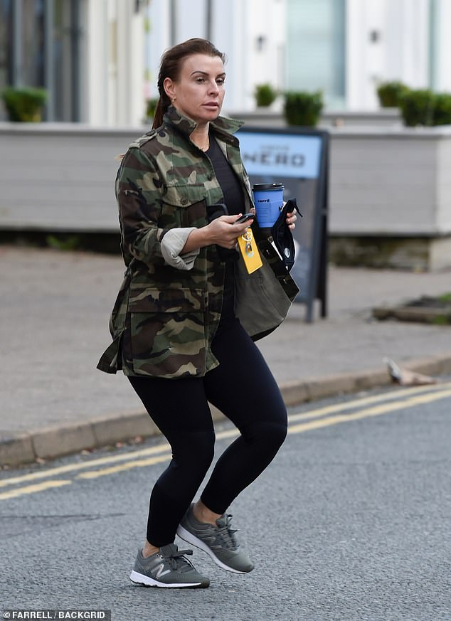 Outfit: The WAG, 34, sported a camo jacket for the outing which she paired with a black T-shirt and matching leggings
