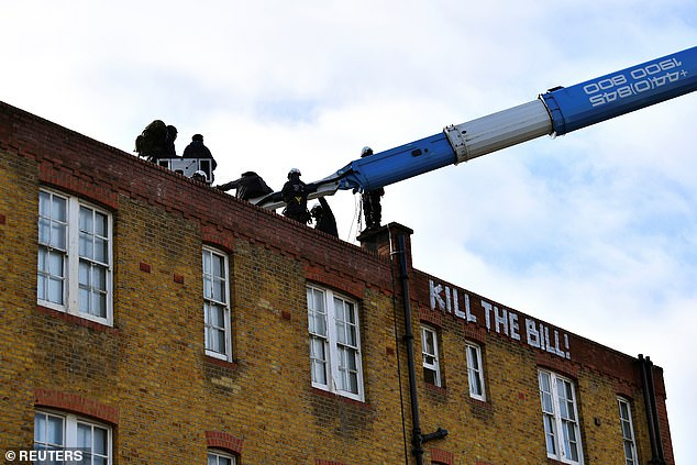 'Kill the Bill' could be seen daubed in white paint across the side of the building as the protestors were removed