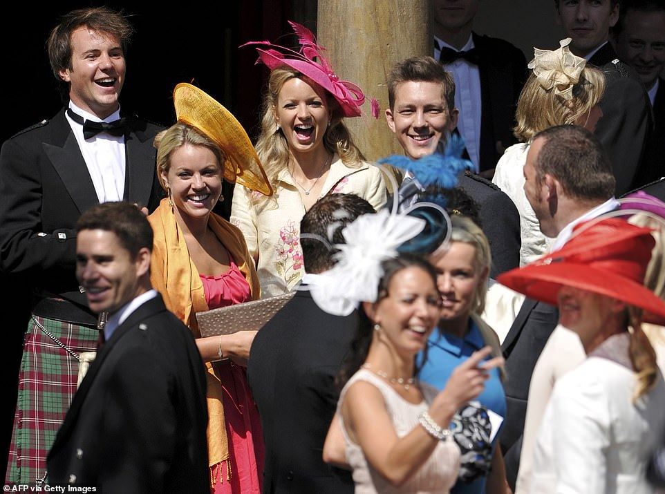 Ms Wallace is understood to be separated from her husband. She was was pictured laughing and cheering (at the back wearing a cream-coloured top and a pink hat) at Zara's wedding to rugby star Mike Tindall in 2011