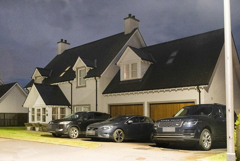 Neighbours of Ms Wallace in her Aberdeenshire village went to the police after his Range Rover was seen on her drive (pictured on Friday night after police visited them)