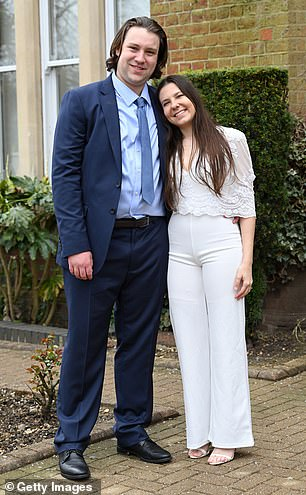 Another pair of newlyweds, Ben and Gabriela Lloyd, grinned as they emerged from St Alban's Registry Office