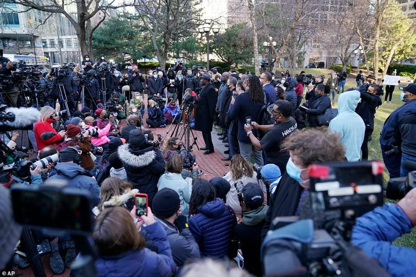 George Floyd family attorney Ben Crump (center) addresses media along with other attorneys and members of George Floyd's family outside the Hennepin County Government Center on Monday