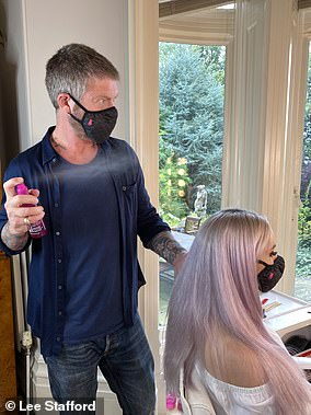 Pictured: Lee prepping a date night hair look as restrictions begin to ease
