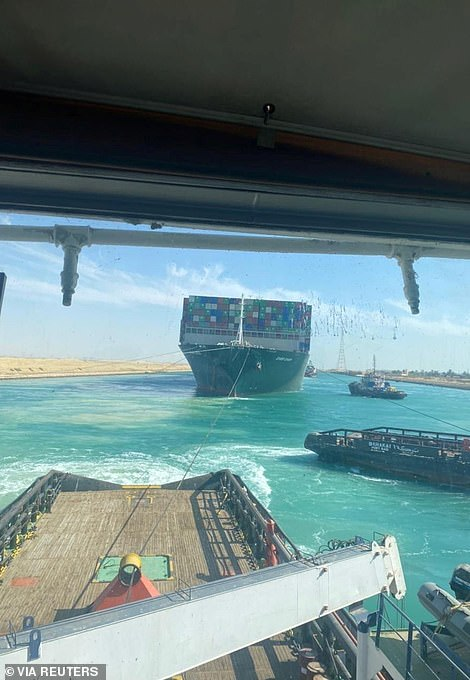 The Ever Given was being pulled by tugboats towards a wide stretch of water nearly a week after it got jammed in the Egyptian shore