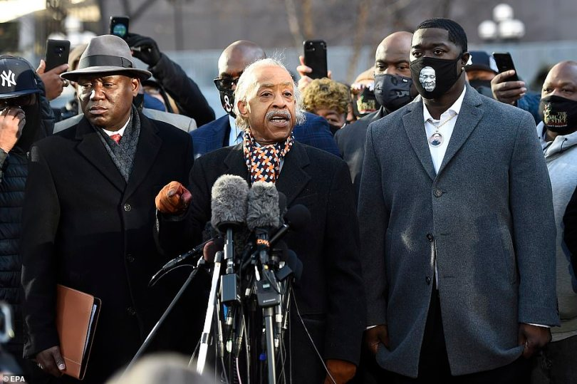 Al Sharpton, center, speaks to the media on the morning of opening statements for the murder trial of former Minneapolis police officer Derek Chauvin, in Minneapolis