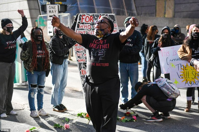 Protesters and supporters of George Floyd's family gathered outside the Hennepin Government Center the morning