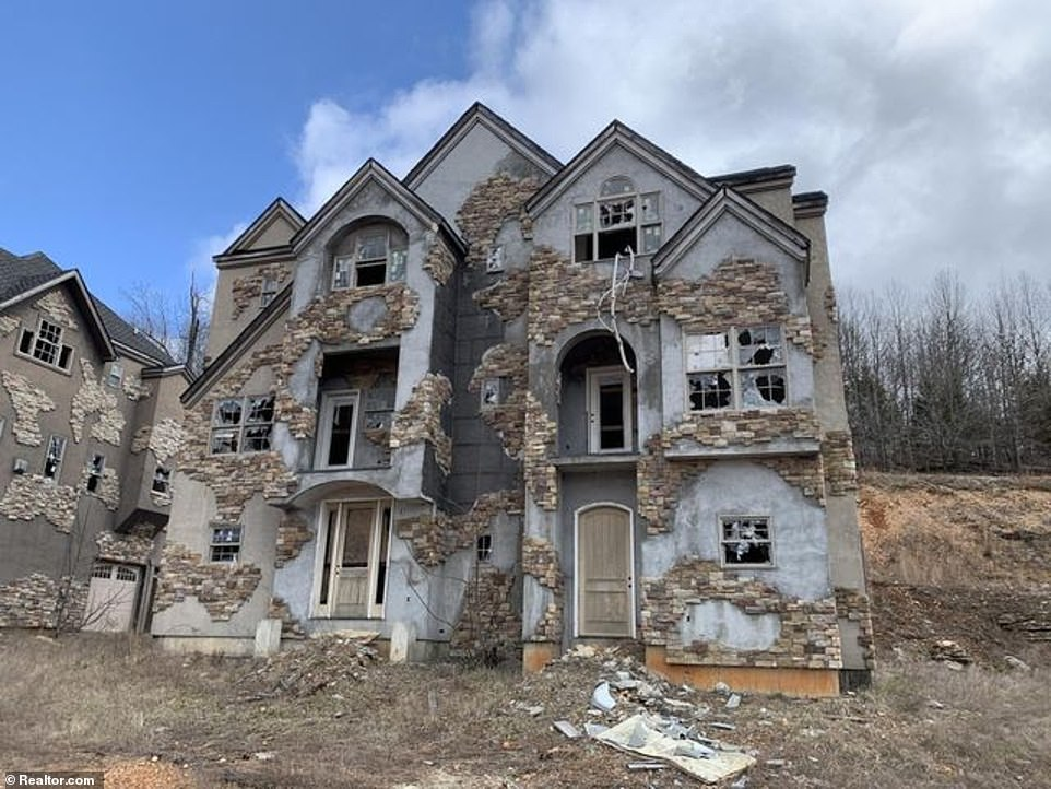 With their smashed windows and busted doors, the McMansions at the failedIndian Ridge Resort have become an eyesore