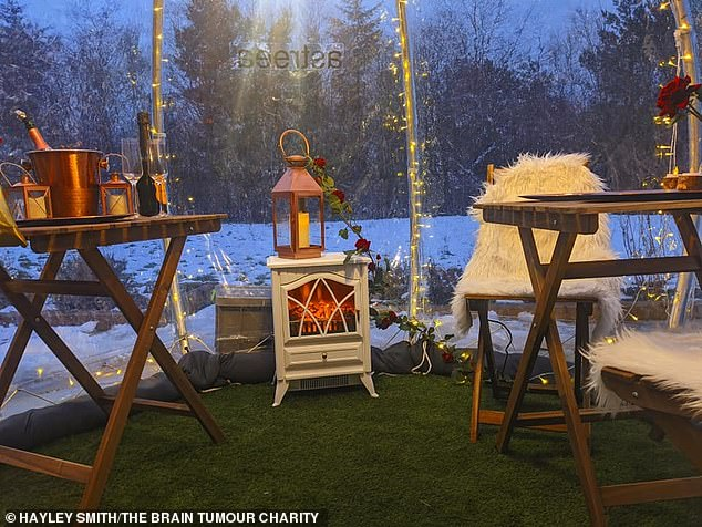 On Valentine's Day, they had a fire unit and fairy lights to give the igloo a cosy and romantic atmosphere, with fur covers on the wooden seats and a rose on the table as they feasted in the snow in their garden