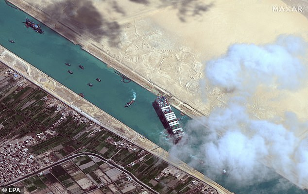 Pictured is a satellite image showing the Ever Given container ship after it has been moved away from the eastern bank of the canal and tugboats trying to reposition the ship, in the Suez Canal. It was blocking the canal for days before being moved