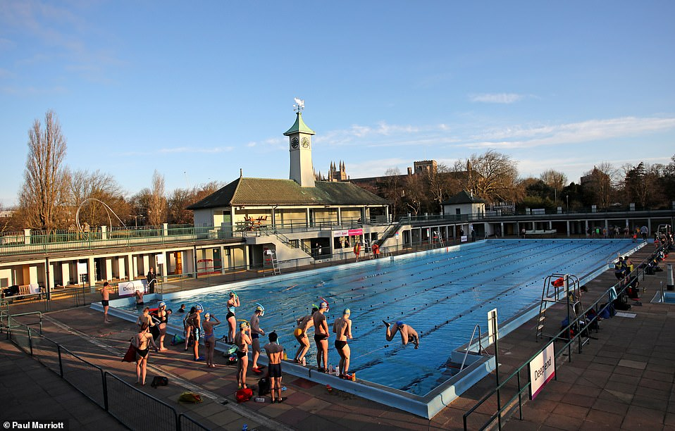 Swimmers enjoying the first dip in the Peterborough Lido for over a year, as it has been unable to open since the first lockdown in March 2020