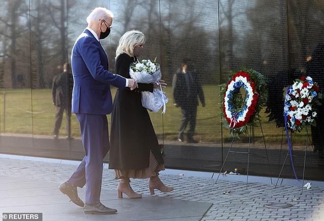President Joe Biden and first lady Jill Biden visited the Vietnam Veterans Memorial Monday to mark National Vietnam War Veterans Day