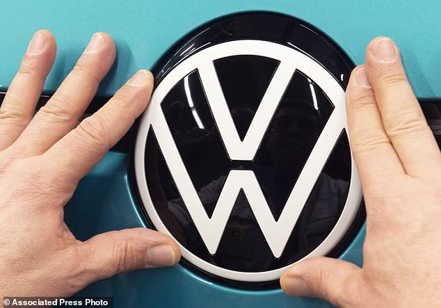 Volkswagen plans to change its brand name in the United States to 'Voltswagen' as it shifts its production increasingly toward electric vehicles. Pictured: In this February 25, 2020, photo, a worker completes an electric car ID.3 body at the assembly line in Zwickau, eastern Germany