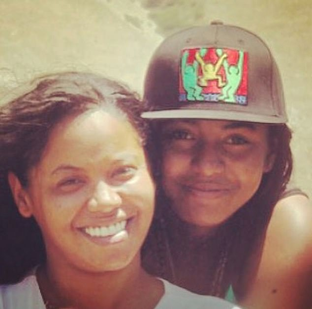 Family heartbreak: Johnson said he was 'heartbroken and devastated' over the death of Maia; she is pictured (right) with her mother and Johnson's ex-wife Shikiri Hightower