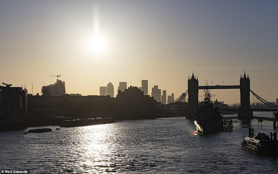Tower Bridge and the Thames was a picturesque sight in the morning sunshine early today