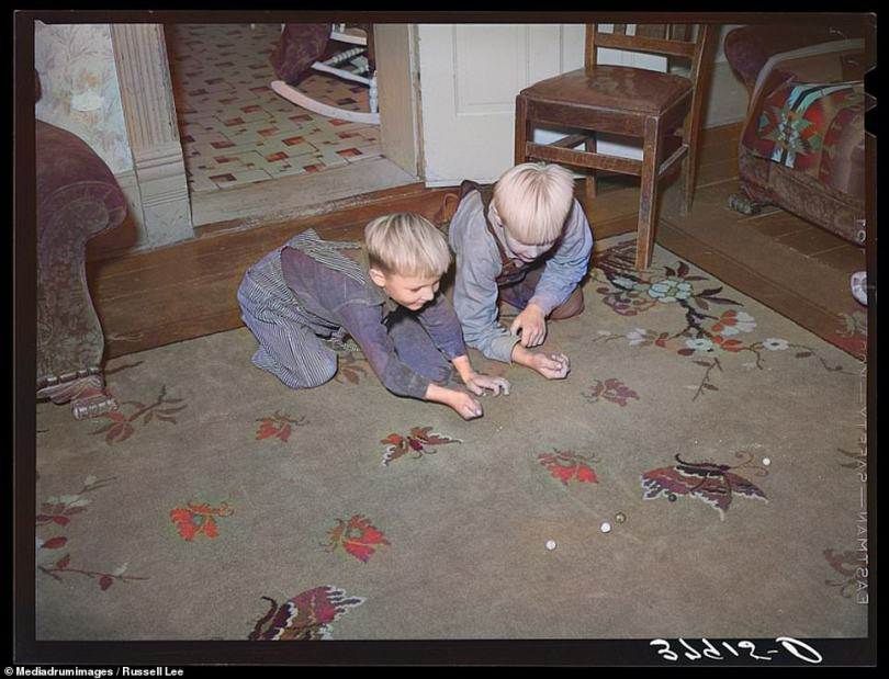 Marbles is another classic game captured among the colorized photographs. In this picture two young boys, from a Mormon family, are seen playing the game on their living room floor in Santa Clara, Utah, 1940. The aim of marbles is to try and knock any number of marbles, positioned in a central spot, out of a marked circle using other marbles