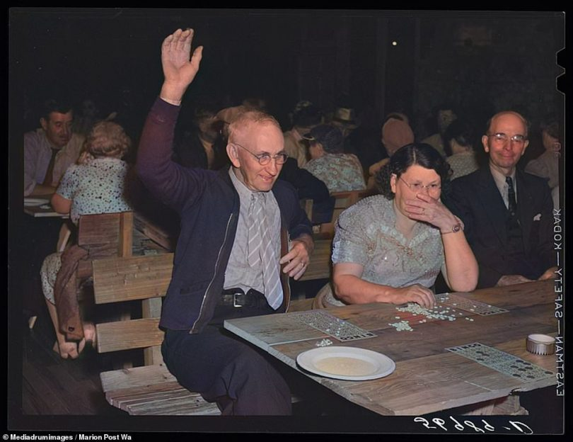 Few games bring out such level of excitement among its player than bingo. This colorized photograph shows a man raising his hand in victory after having won a round at the Sarasota Trailer Park in Florida in 1941. Bingo is thought to be around 500 years old - inspired by the Italian game of 'Il Gioco del Lotto d'Italia'
