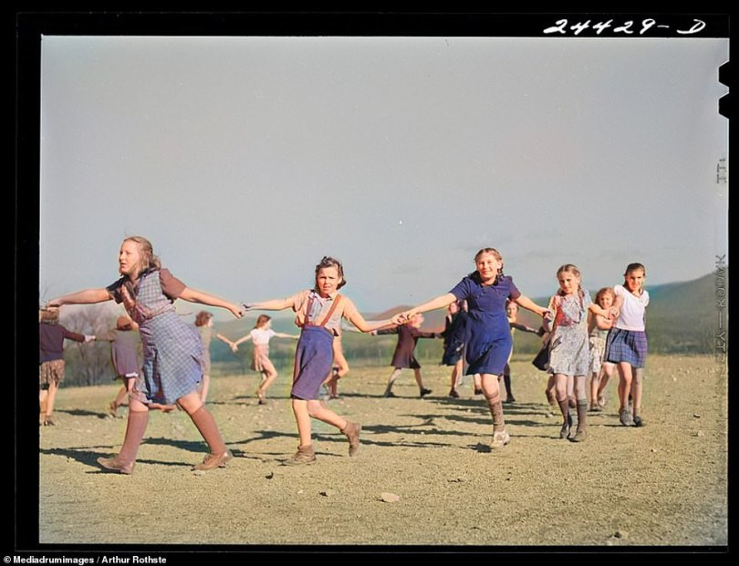 Another pastime which has stood the test of time and is commonly now seen played by schoolchildren are singing games. This group of young girls in Dailey, West Virginia, 1941, are seen holding hands in a large circle and skipping round together while singing a song