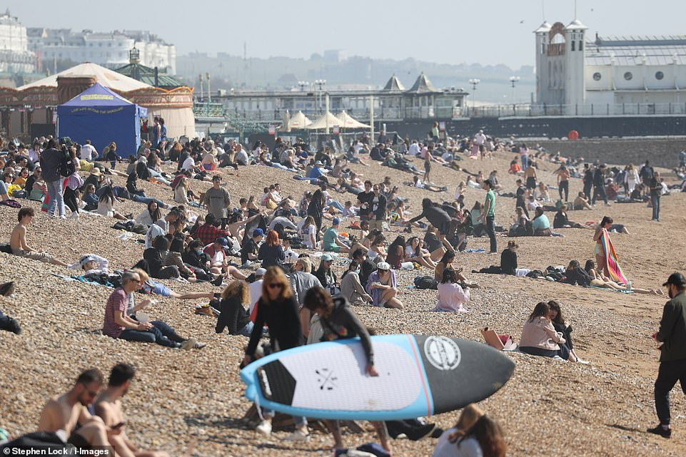 People flock to Brighton beach this afternoon to enjoy the warm and sunny weather on the South Coast