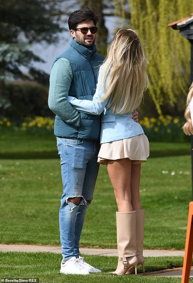 Strutting her stuff: The reality star, 27, who put on a leggy display in a plunging silk minidress and a powder blue blazer, wrapped her arms around Dan at the Easter themed bash