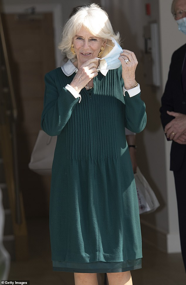 Once outside, the Duchess was quick to remove her face mask and enjoy the warm spring-time sunshine
