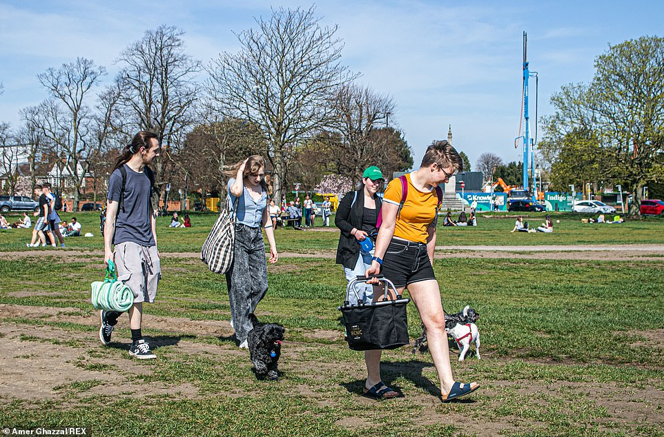 The warm spring sunshine has encouraged friends to meet outdoors on Wimbledon Common in South West London today