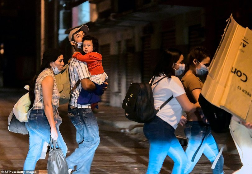 SAN PEDRO SULA, HONDURAS: Families are seen heading towards the Guatemalan border with little belongings for the journey
