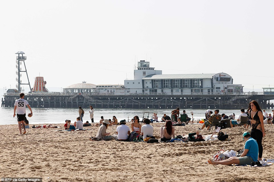 Members of the public enjoy the beach in Bournemouth in Dorset as parts of England enjoy warm temperatures