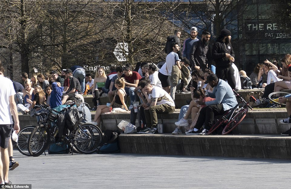 People make the most of the warmth on the South Bank in London this morning as England enjoys a mini-heatwave