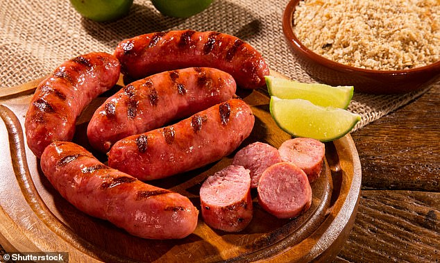 Processed meats include sausages, salami and cured bacon, pâté and beefburgers. Processed meats are generally high in fat and are often high in salt too. Pictured, grilled sausage at aBrazilian barbecue (stock image)