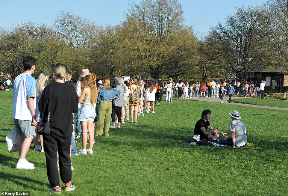 Park visitors queued for the toilets in Primrose Hill today. The line stretched back several meters as countless sunseekers rushed to Britain's green spaces