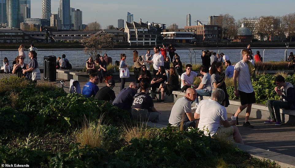 Others chose to sit in a more-shaded area in Greenwich, London, as the capital soaked up the sun today